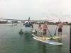 SUP next to seaplane